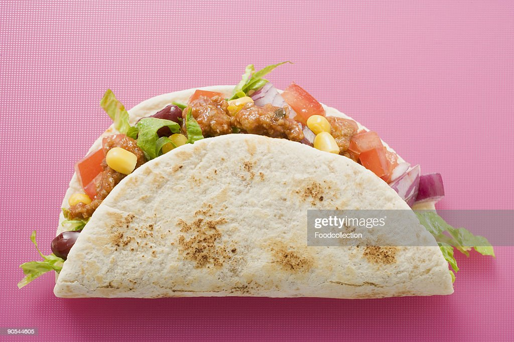 Taco on pink background, close up : Stock Photo