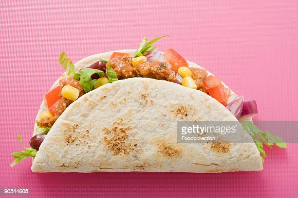 taco on pink background, close up - pink taco stock photos and pictures