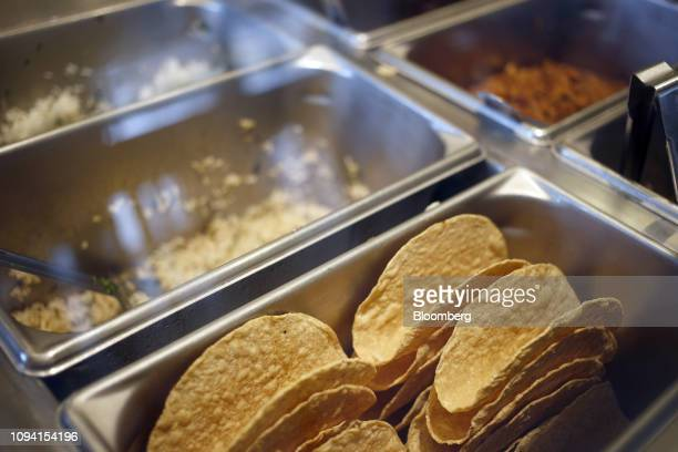 Taco shells sit in a bin at a Chipotle Mexican Grill Inc restaurant in Louisville Kentucky US on Saturday Feb 2 2019 Chipotle Mexican Grill Inc is...