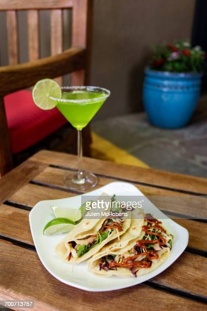 Tacos on plate with margarita