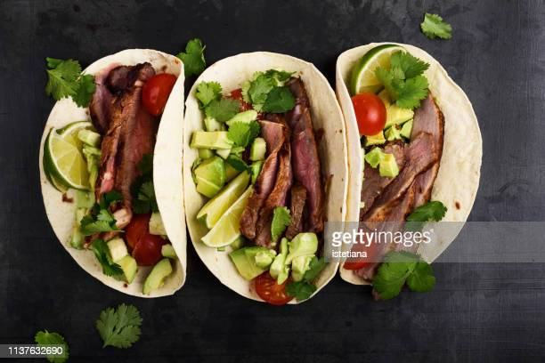 tacos with grilled steak and vegetables - tortilla flatbread stock photos and pictures