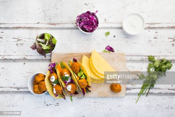 Tacos with mixed salad, sweet patato Falafel, carrot, red cabbage, yoghurt sauce, parsley and black sesame