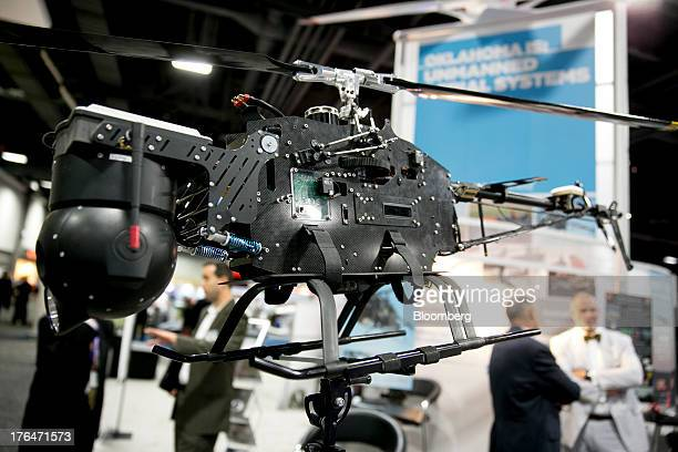 A Tactical Electronics and Military Supply LLC Raptr unmanned aircraft system sits on the exhibition floor at the Association for Unmanned Vehicle...