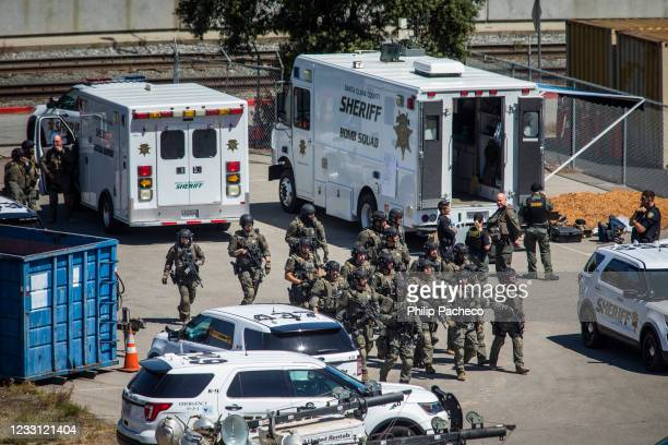 Tactical law enforcement officers move through the Valley Transportation Authority light-rail yard where a mass shooting occurred on May 26, 2021 in...