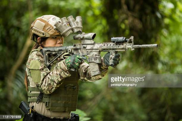 tactical military airsoft soldiers in jungle - ammunition magazine stock photos and pictures