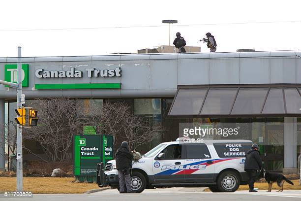 POLICE tactical units and the SIU secure the intersection of Kipling and Queensway after an incident at TD Bank Saturday morning