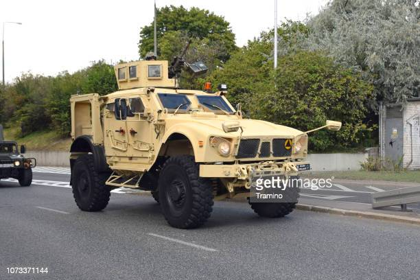 tactical vehicle oshkosh m-atv mrap driving on the street - armored vehicle stock pictures, royalty-free photos & images
