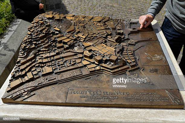 bronze touch map of napoli including braille - braille stock photos and pictures