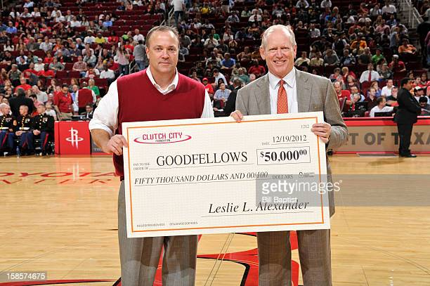 Tad Brown CEO of the Houston Rockets presents Jack Sweeney Chairman of the Houston Chronicle with a check for $50000 to the Goodfellows organization...