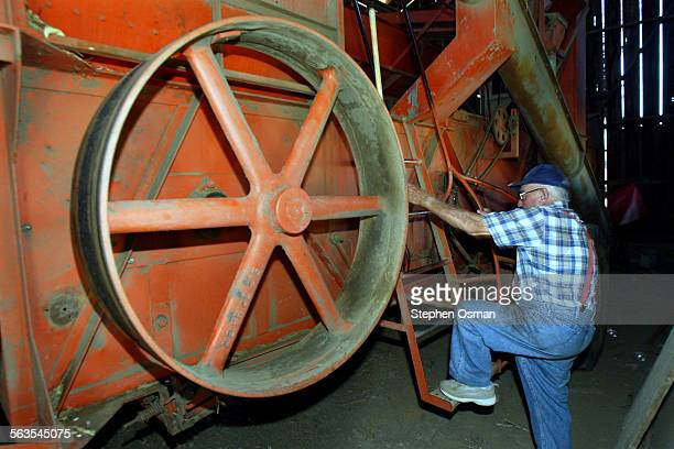Tad DeBoni 91, climbs the ladder onto his 1949 lima bean harvester that he still uses today. Tad DeBoni proves the adage that farmers never retire....