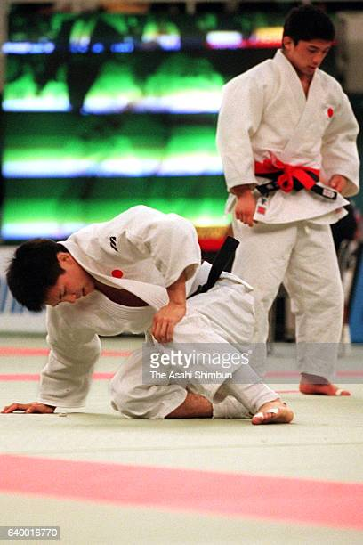 Tadahiro Nomura holds his left knee during his 60kg semifinal against Masato Uchishiba of Japan during day one of the Kano Jigoro Cup Tokyo...