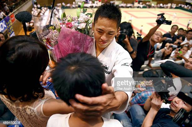 Tadahiro Nomura hugs with his family after his defeat in the Men's 60kg third round against Ryudo Tsubaki during the All Japan Businessmen Judo...