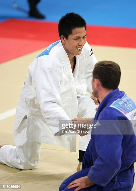Tadahiro Nomura of Japan and Nestor Khergiani of Georgia shake hands after the Judo Men's 60kg final at the Ano Liossia Olympic Hall during day one...