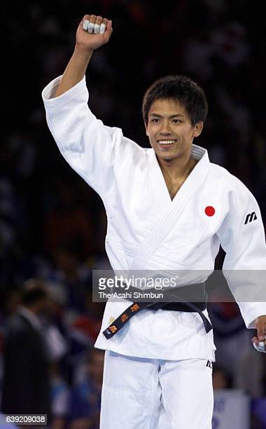 Tadahiro Nomura of Japan celebrates winning the gold medal after winning the Men's Judo 60kg gold medal match against Jung Bukyung of South Korea...