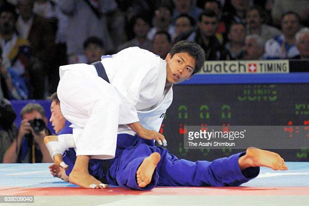 Tadahiro Nomura of Japan celebrates winning the gold medal after the Men's Judo 60kg gold medal match against Jung Bukyung of South Korea during the...
