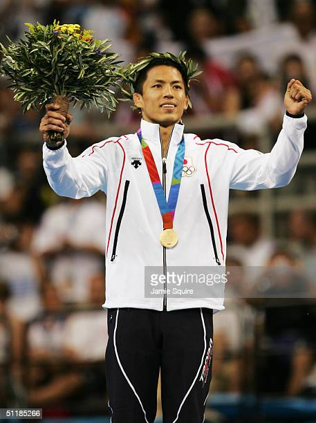 Tadahiro Nomura of Japan receives the gold medal in the men's judo -60 kg class event on August 14, 2004 during the Athens 2004 Summer Olympic Games...