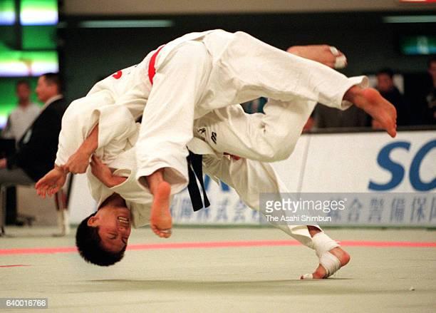 Tadahiro Nomura throws Masato Uchishiba in the -60kg semifinal during day one of the Kano Jigoro Cup Tokyo International Judo Championships at Nippon...