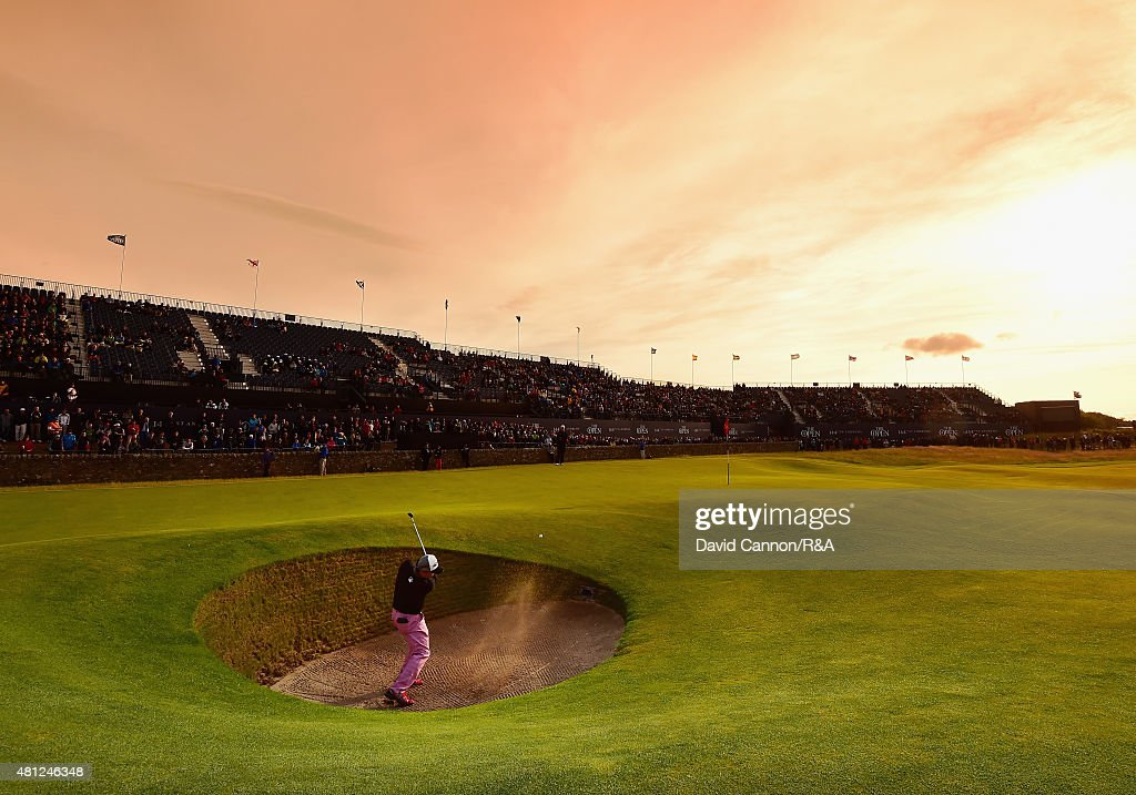 Tadahiro Takayama of the United States hits his third shot from a bunker on the 17th hole during the second round of the 144th Open Championship at The Old Course on July 18, 2015 in St Andrews, Scotland.