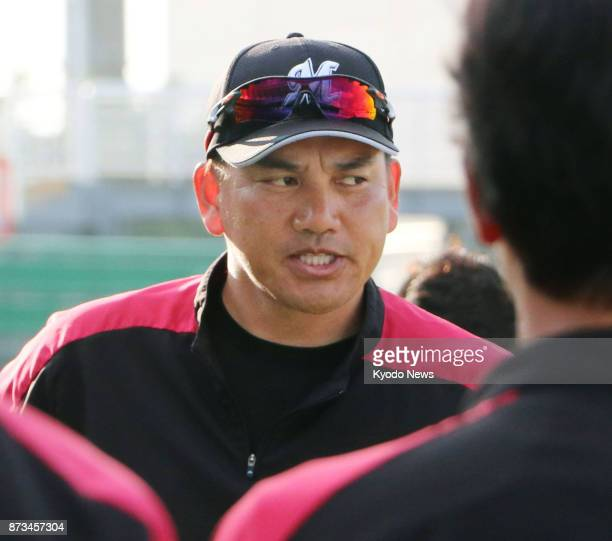 Tadahito Iguchi new manager of the Lotte Marines and a member of the 2005 World Series champion Chicago White Sox speaks to his players during the...
