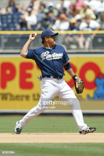Tadahito Iguchi of the San Diego Padres makes the throw to first base during the game against the Milwaukee Brewers at Petco Park in San Diego...