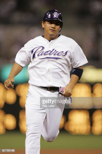 Tadahito Iguchi of the San Diego Padres runs to third base during the game against the Arizona Diamondbacks at Petco Park in San Diego California on...
