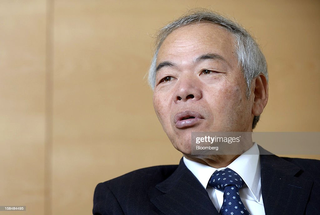 Tadahito Yamamoto, president of Fuji Xerox Co., speaks during an interview in Tokyo, Japan, on Monday, Dec. 17, 2012. Fuji Xerox, Japan's biggest maker of color printers, may miss its sales target for the next fiscal year because of slowing demand. Photographer: Akio Kon/Bloomberg via Getty Images