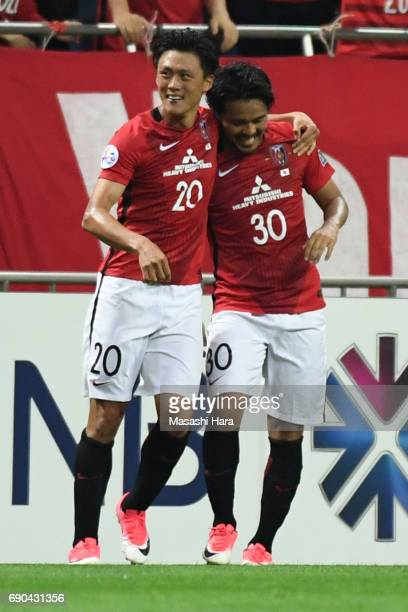 Tadanari Lee and Shinzo Koroki of Urawa Red Diamonds celebrate the second goal during the AFC Champions League Round of 16 match between Urawa Red...