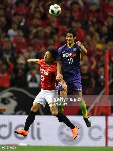 Tadanari Lee of Urawa Red Diamonds and Sho Sasaki of Sanfrecce Hiroshima compete for the ball during the J.League J1 match between Urawa Red Diamonds...