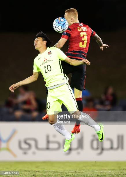 Tadanari Lee of Urawa Red Diamonds is challenged by Jack Clisby of the Wanderers during the AFC Asian Champions League match between the Western...