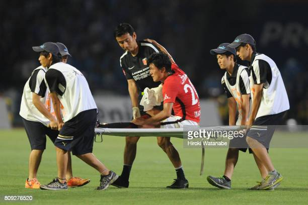 Tadanari Lee of Urawa Red Diamonds is taken off by a stretcher during the JLeague J1 match between Kawasaki Frontale and Urawa Red Diamonds at...