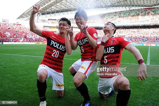 Tadanari Lee Yuki Muto and Tomoaki Makino of Urawa Red Diamonds celebrate their team's 31 win in the JLeague match between Urawa Red Diamonds and...