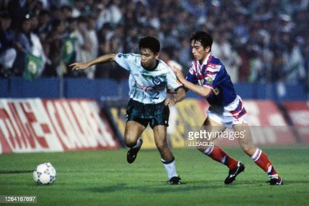 Tadashi Nakamura of Verdy Kawasaki and Takahiro Yamada of Yokohama Marinos compete for the ball during the JLeague Suntory Series match between...