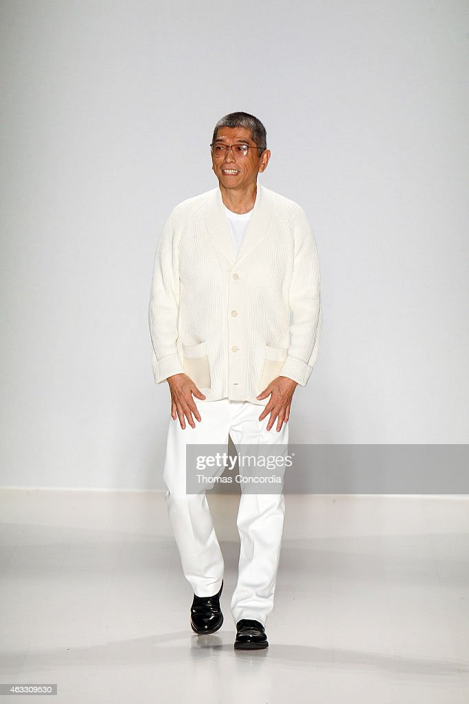 Tadashi Shoji greets the audience after presenting his Fall 2015 collection during Mercedes-Benz Fashion Week Fall 2015 at The Salon at Lincoln Center on February 12, 2015 in New York City.