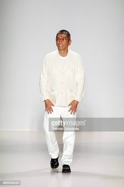 Tadashi Shoji greets the audience after presenting his Fall 2015 collection during MercedesBenz Fashion Week Fall 2015 at The Salon at Lincoln Center...