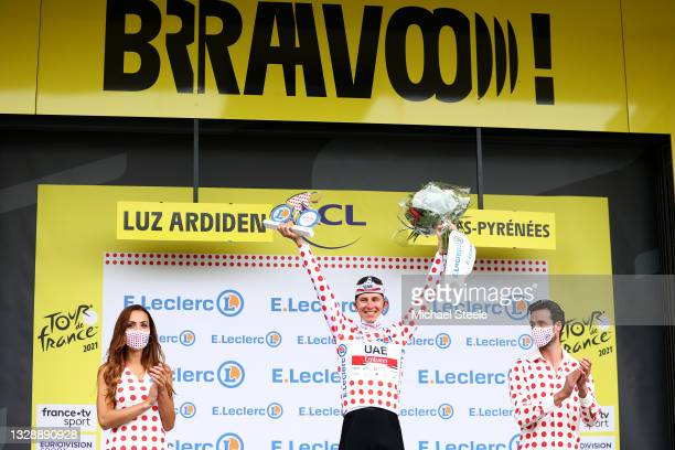 Tadej Pogačar of Slovenia and UAE-Team Emirates Polka Dot Mountain Jersey celebrates at podium during the 108th Tour de France 2021, Stage 18 a...