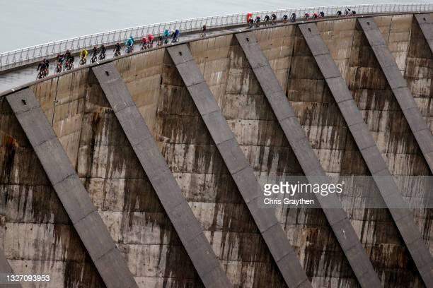 Tadej Pogačar of Slovenia and UAE-Team Emirates yellow leader jersey & The peloton passing through Col du Pré during the 108th Tour de France 2021,...