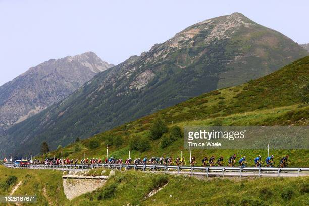 Tadej Pogačar of Slovenia and UAE-Team Emirates yellow leader jersey & The peloton passing through Col de Puymorens landscape during the 108th Tour...