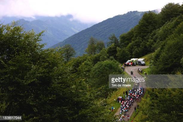 Tadej Pogačar of Slovenia and UAE-Team Emirates yellow leader jersey & The peloton passing through Col de la Core landscape during the 108th Tour de...