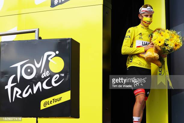 Tadej Pogačar of Slovenia and UAE-Team Emirates yellow leader jersey celebrates at podium during the 108th Tour de France 2021, Stage 19 a 207km...