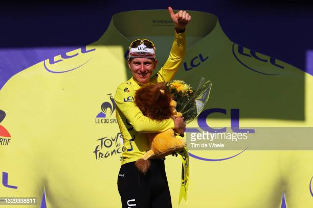 Tadej Pogačar of Slovenia and UAE-Team Emirates yellow leader jersey celebrates at podium during the 108th Tour de France 2021, Stage 20 a 30,8km...