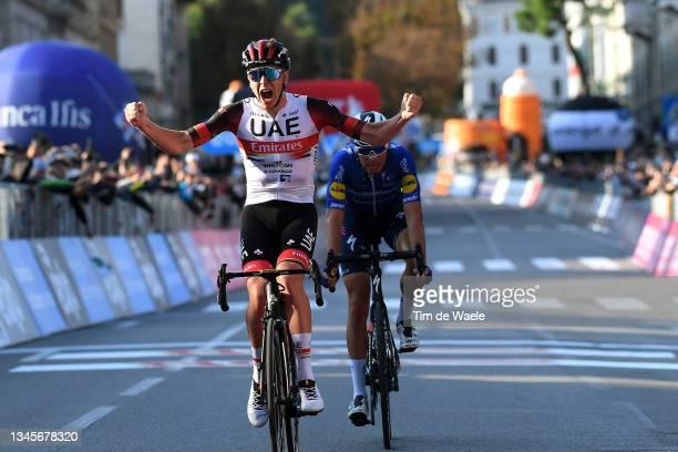 Tadej Pogacar of Slovenia and UAE Team Emirates celebrates at finish line as race winner ahead of Fausto Masnada of Italy and Team Deceuninck -...