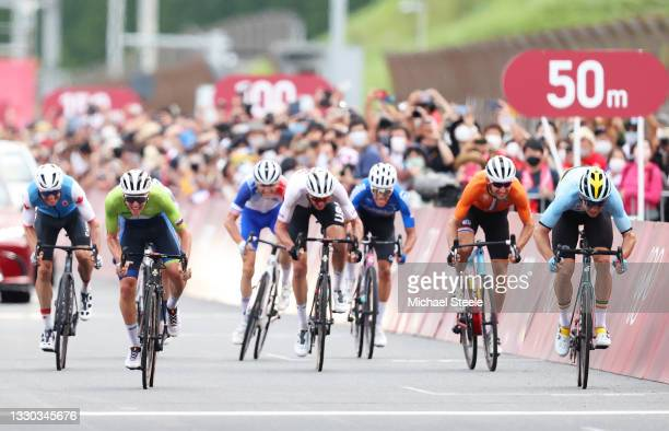 Tadej Pogacar of Team Slovenia bronze medal & Wout van Aert of Team Belgium silver medalist sprints on arrival during the Men's road race at the Fuji...