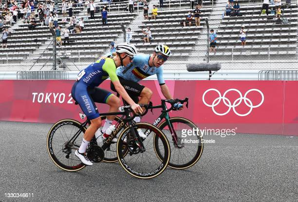 Tadej Pogacar of Team Slovenia bronze medal & Wout van Aert of Team Belgium silver medalist celebrate on arrival during the Men's road race at the...