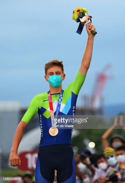 Tadej Pogacar of Team Slovenia poses with the bronze medal after the Men's road race at the Fuji International Speedway on day one of the Tokyo 2020...