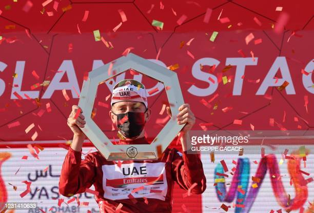 Tadej Pogacar of Team UAE Emirates celebrates on the podium after winning the UAE Cycling Tour from Yas Mall to Abu Dhabi Breakwater, on February 27,...