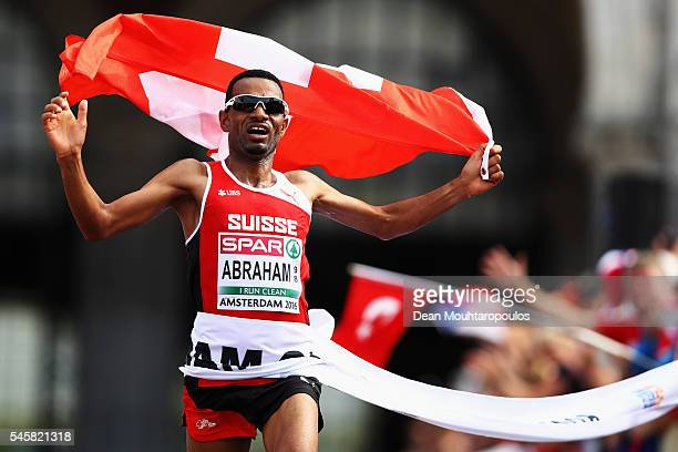 Tadesse Abraham of Switzerland celebrates as he crosses the finish line and wins the gold medal in the Half Marathon Men on day 5 of the 23rd...