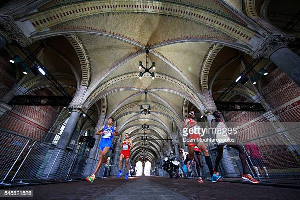 Tadesse Abraham of Switzerland Kaan Kigen Ozbilen of Turkey and Daniele Meucci of Italy lead in the Half Marathon Men from on day 5 of the 23rd...