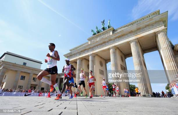 Tadesse Abraham of Switzerland leads the pack as they run through the Brandenburg Gate in the Men's Marathon final during day six of the 24th...