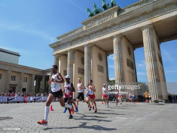 Tadesse Abraham of Switzerland Lemawork Ketema of Austria and Koen Naert of Belgium compete in men's marathon on August 12 2018 in Berlin Germany
