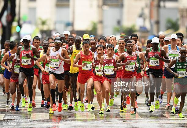 Tadesse Abraham of Switzerland Renxue Zhu of China and Alemu Bekele of Bahrain lead the pack during the Men's Marathon on Day 16 of the Rio 2016...